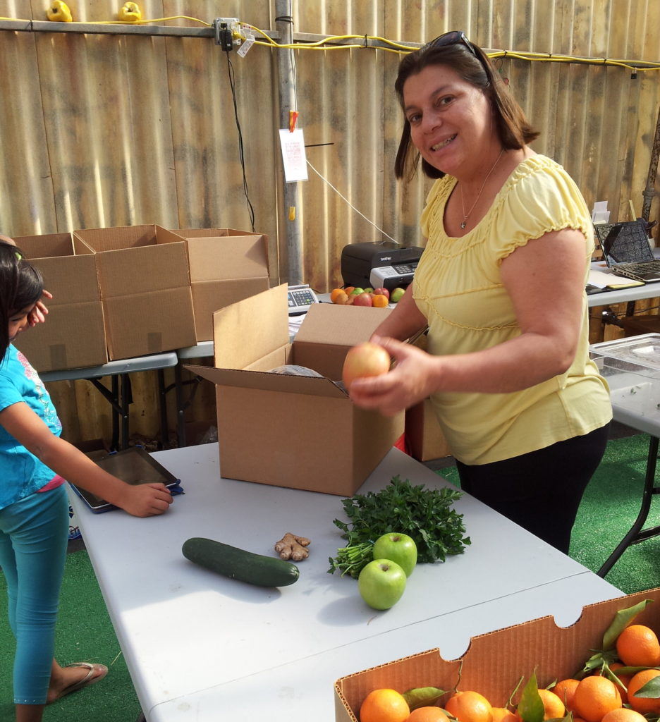 Ivonne helping to pack up delivery orders during Daily Harvest's early days.